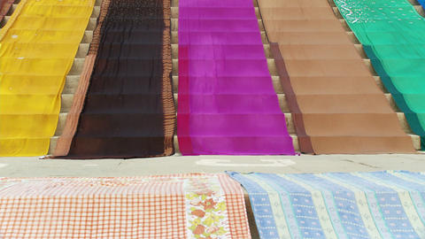 Colorful fabric on steps Live Action