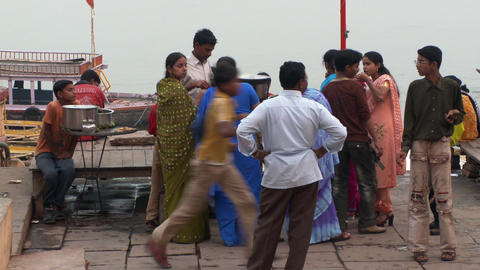 Group of people getting food to eat at the wharf in an Indian town Footage