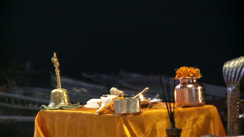 Incense burns by a table with ceremony items on it Footage