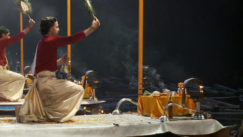 Two men fanning incense in an incense offering ceremony Footage