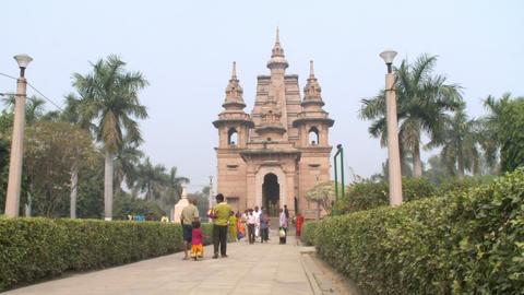 People walking up the path to the Mulagandhakuti shrine at Sarnath Footage