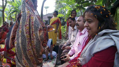 Man and women receiving the bindi at women meeting Footage