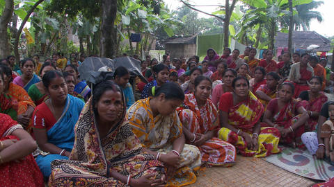 Small crowd of Indian women sitting on the ground chanting Live Action