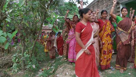Women chanting, walking and raising arms at women meeting Live Action
