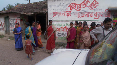 Small group of Indian women standing on a dirt street Live Action