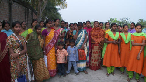 Group of Indian women and children standing in a group Live Action