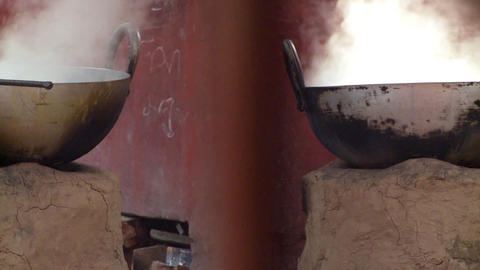 Two pots, on primitive hearth stoves, steaming Live Action