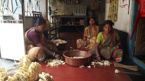 Indian women working making flower petals Footage
