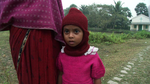 Young Indian girl next to her mother in front of a Christian church Footage