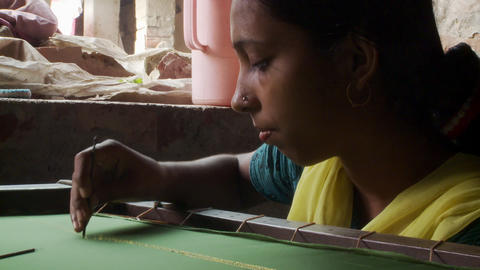 Indian women embroidering fabric Footage
