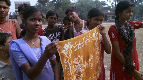 Indian women showing embroidered shawls Footage
