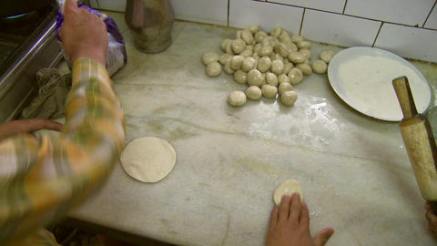 Two men rolling out dough with rolling pin Footage