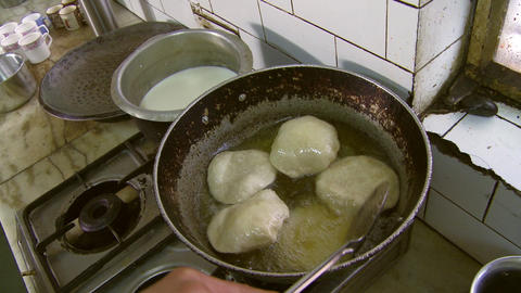 Over head shot of dough cooking in grease Footage