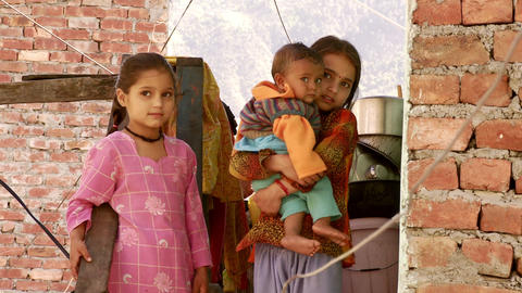 View of two girls hold toddler Footage