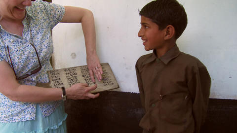 Women tests boys math skills in classroom in India Live Action