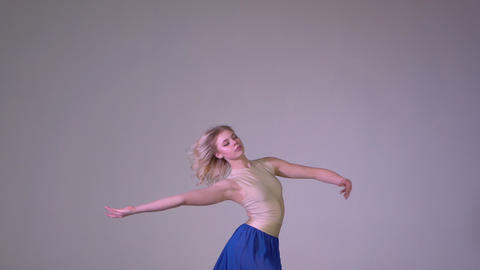 Beautiful young girl performing alone, makes slow ballet movements Footage