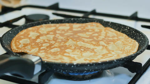 Cooking pancakes in a pan, hot dough Footage