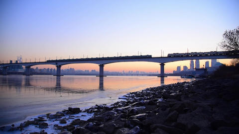 South Korean Metropolitan Railway runs across the Han Riverin on the morning in Seoul Live Action