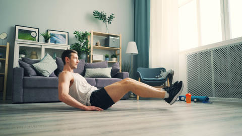 Good-looking man doing abdomen crunches different positions wearing sportswear Footage