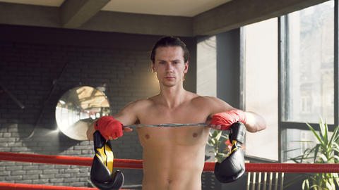 Portrait shot of confident young man in the boxing club Live Action