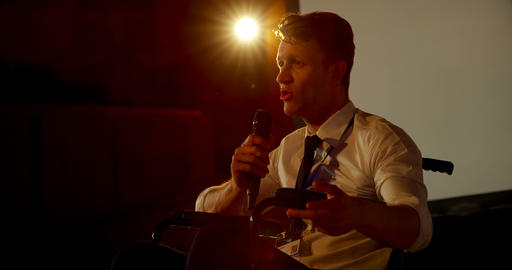 Young Caucasian disabled businessman speaking in business seminar in auditorium 4k Live Action