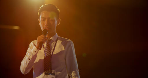 Young Asian businessman speaking in business seminar at auditorium 4k Live Action