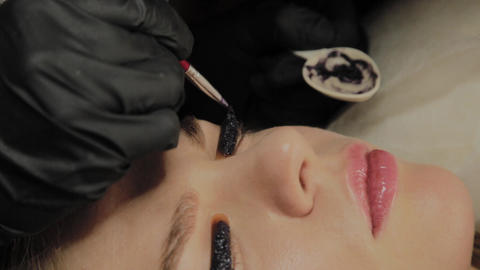 A very beautiful girl in a beauty salon does a lamination lashes. Beautician Footage