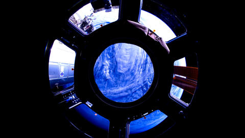Earth through the porthole of the ISS. Elements of this video furnished by NASA Live Action