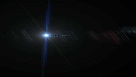 Beautiful blue digital lens flare in black background horizontal frame Live Action