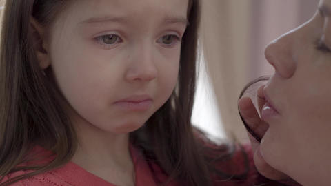 Portrait of a little sad girl with big eyes crying close up. Little kid is upset Live Action