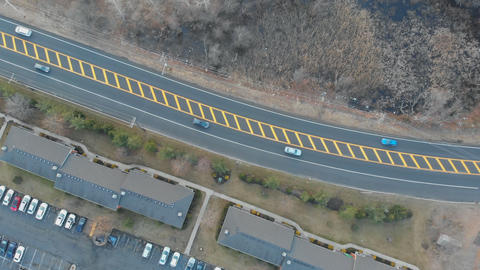 Various drone shots of a road and cars tracks can bee seen on the road Footage