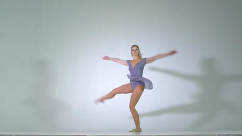 4k - Attractive young girl spinning ballet pirouette isolated Live Action