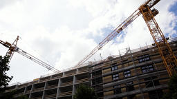Industrial Cranes Working on Residential Structure Live Action