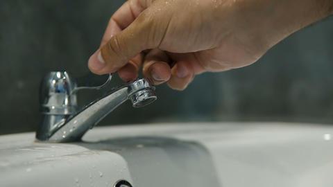 Turning water on bathroom sink Footage