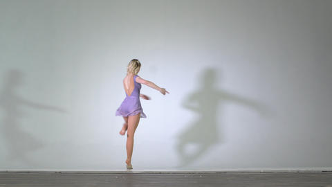 4k - Attractive ballerina dancing and performs pirouette isolated Live Action