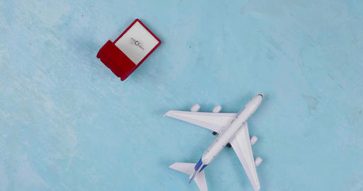 Toy plane and engagement ring. Travel for a proposal Live Action