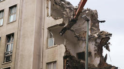 Demolition Excavator Arm Crushing Apartment Building Wall Live Action