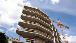 Construction Crane at Work on Building Under Construction Live Action