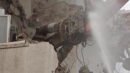 High Reach Demolition Excavator Breaking Wall Pieces Footage