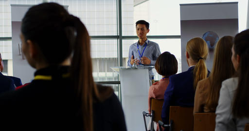 Male speaker speaking to the public in the business seminar 4k Live Action