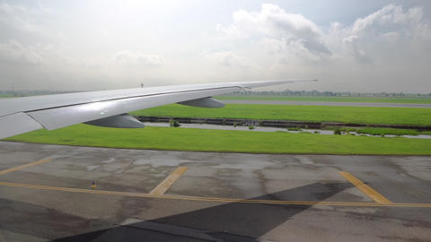 the plane on the takeoff strip is preparing for takeoff. view from the window on Live Action