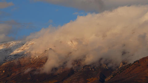 Timelapse of clouds blowing off Mt. Timpanogos, UT Footage