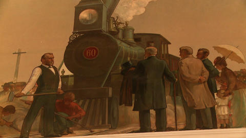 Tight shot of a painting of the Transcontinental Railroad ceremony Live Action