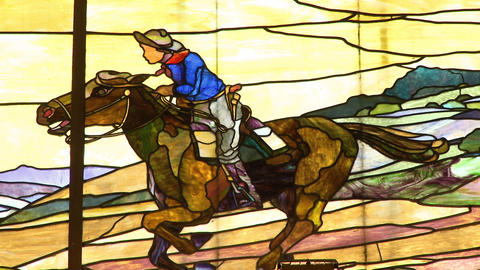 Stained glass window of a Pony Express rider Live Action