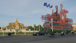 Traffic passes Royal Palace park,Phnom Penh,Cambodia Footage