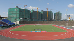Football match in national stadium with contruction site,Phnom Penh,Cambodia Footage