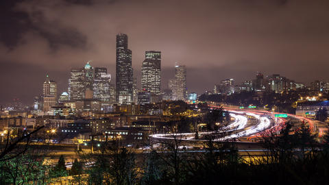Time lapse of traffic on the freeway looking toward Skyscrapers in Seattle and C Footage