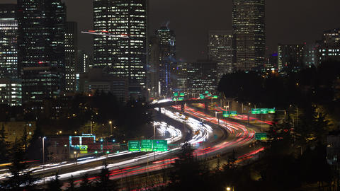Time lapse of the inner city and traffice on highway 5 in Seattle at night Footage
