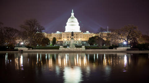 Time lapse of the US Capitol at night with reflection Footage