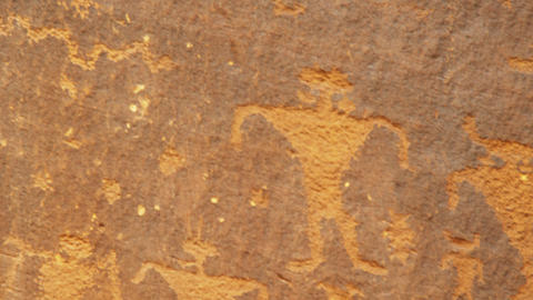 Close-up panning shot of ancient drawings on rocks in Utah Footage